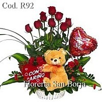 roses and teddy bear in a basket